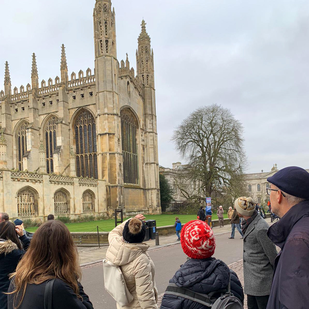 A tour guide and her tour group in front of King's College Chapel in the city of Cambridge.
